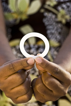A women holds a dapirivine ring in her hands.