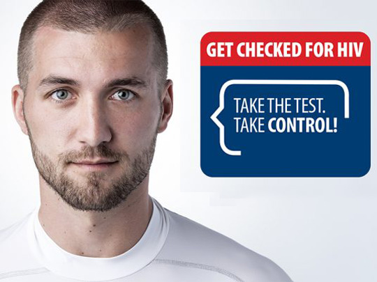 Photo of a man wearing a t-shirt. Get checked for HIV. Take the test. Take control!