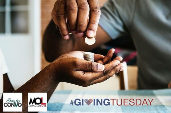 Photo of one person dropping coins into the hands of a second person. Giving Tuesday.