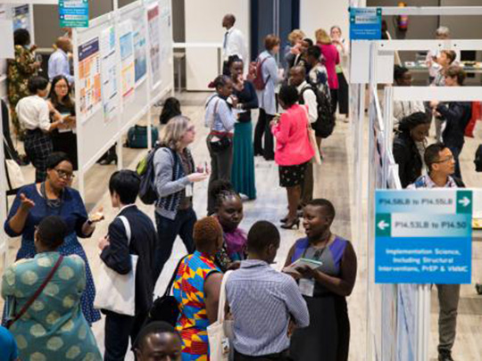HIV R4P attendees mingle at a poster session