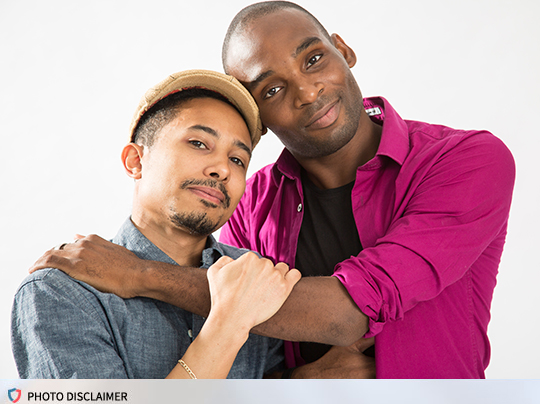 Photo of two men holding each other.