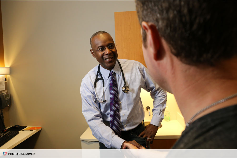 Doctor talking with patient in an office